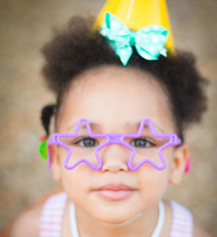 child with star glasses